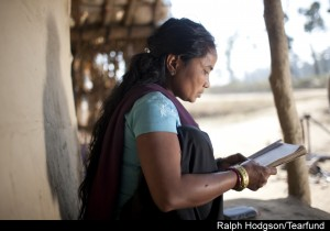 Dhandevi Seaming (32) reading bible at her home, ShivNagar community ,Tikapur, Western Nepal.TF Partner:Sagoal